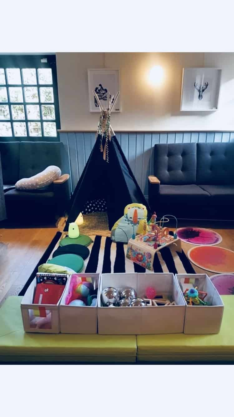 A baby play area including a den and toys at Boston Tea Party Solihull