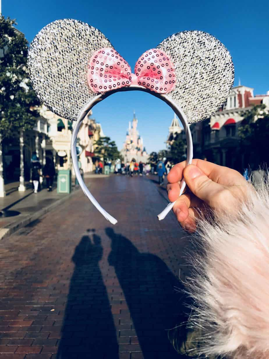 Glittered disney ears infront of the castle at Disneyland Paris