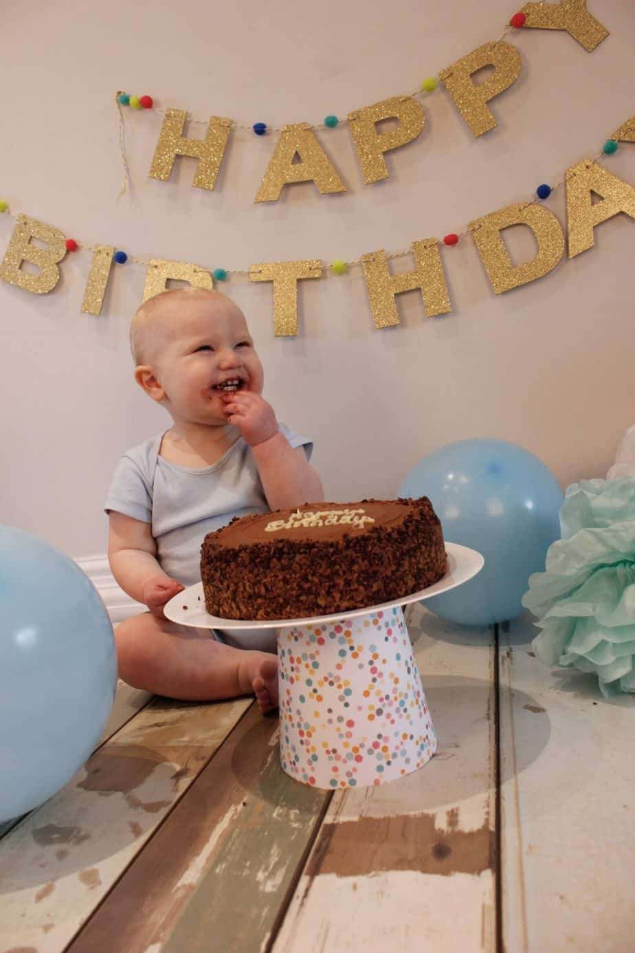 Baby K enjoying his cake smash
