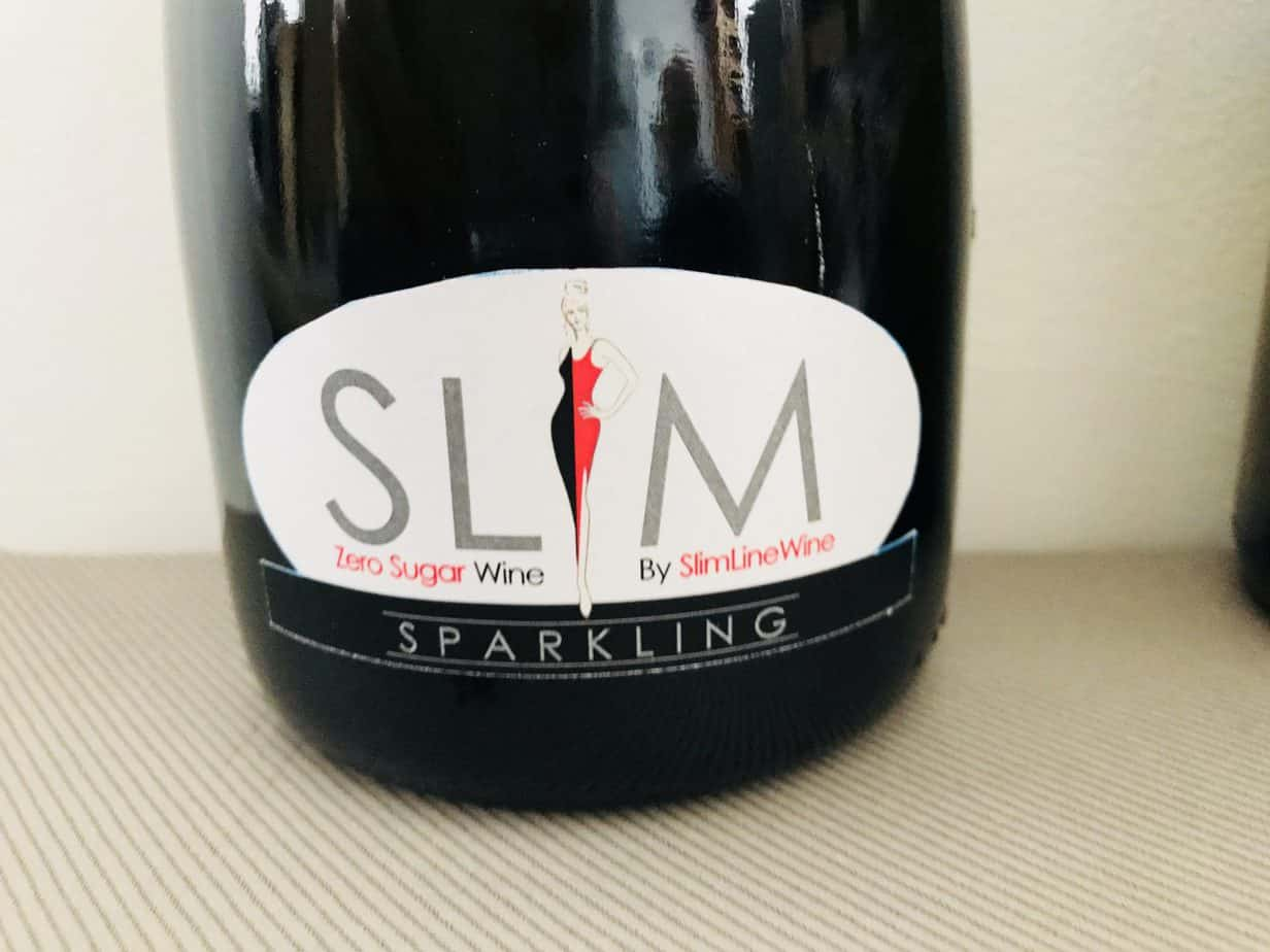 Close up photo of the slimline logo on the sparking wine bottle