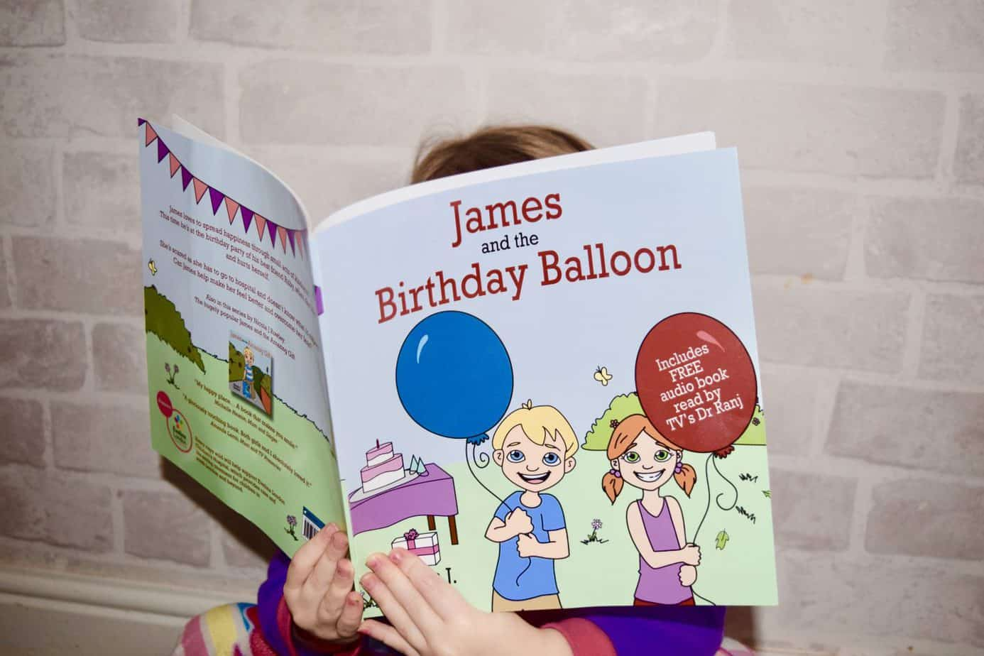 Willow reading the book James and the Birthday Balloon