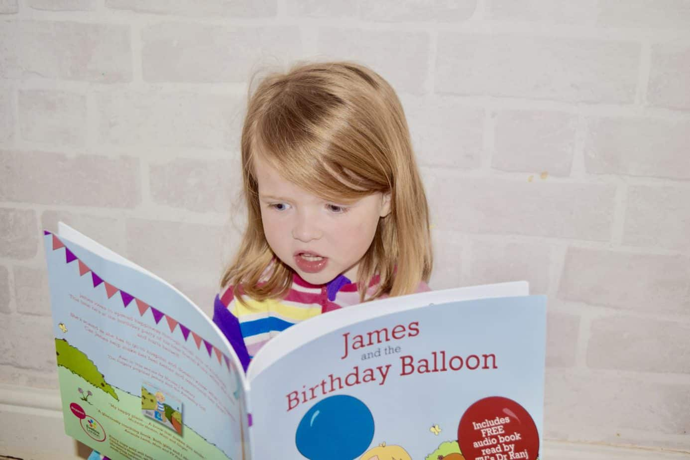 W reading the book James and the Birthday Balloon