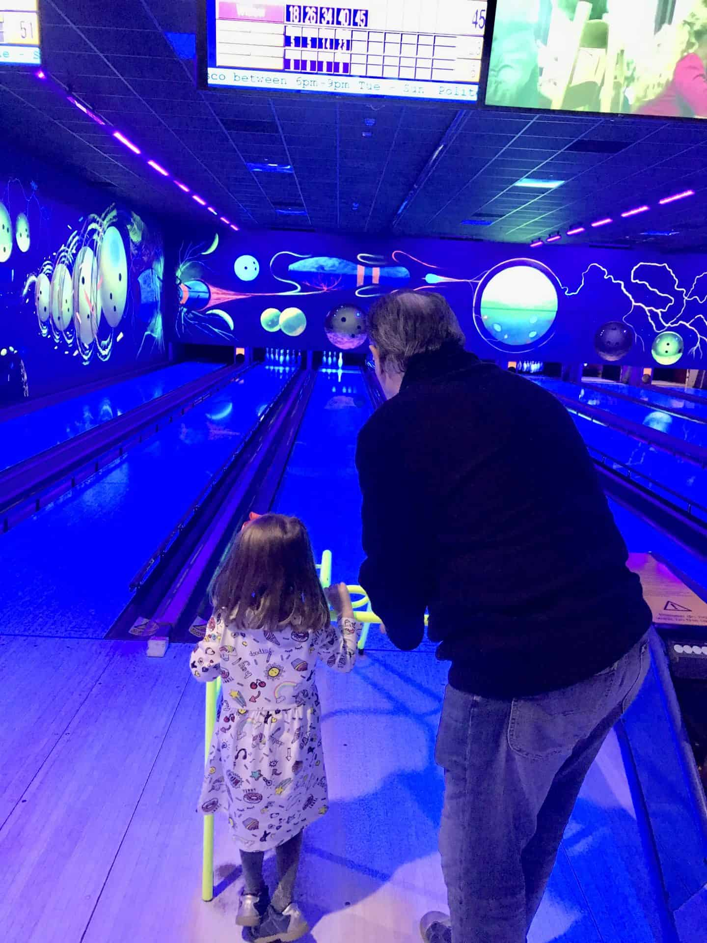 W and her grandad bowling at center parcs