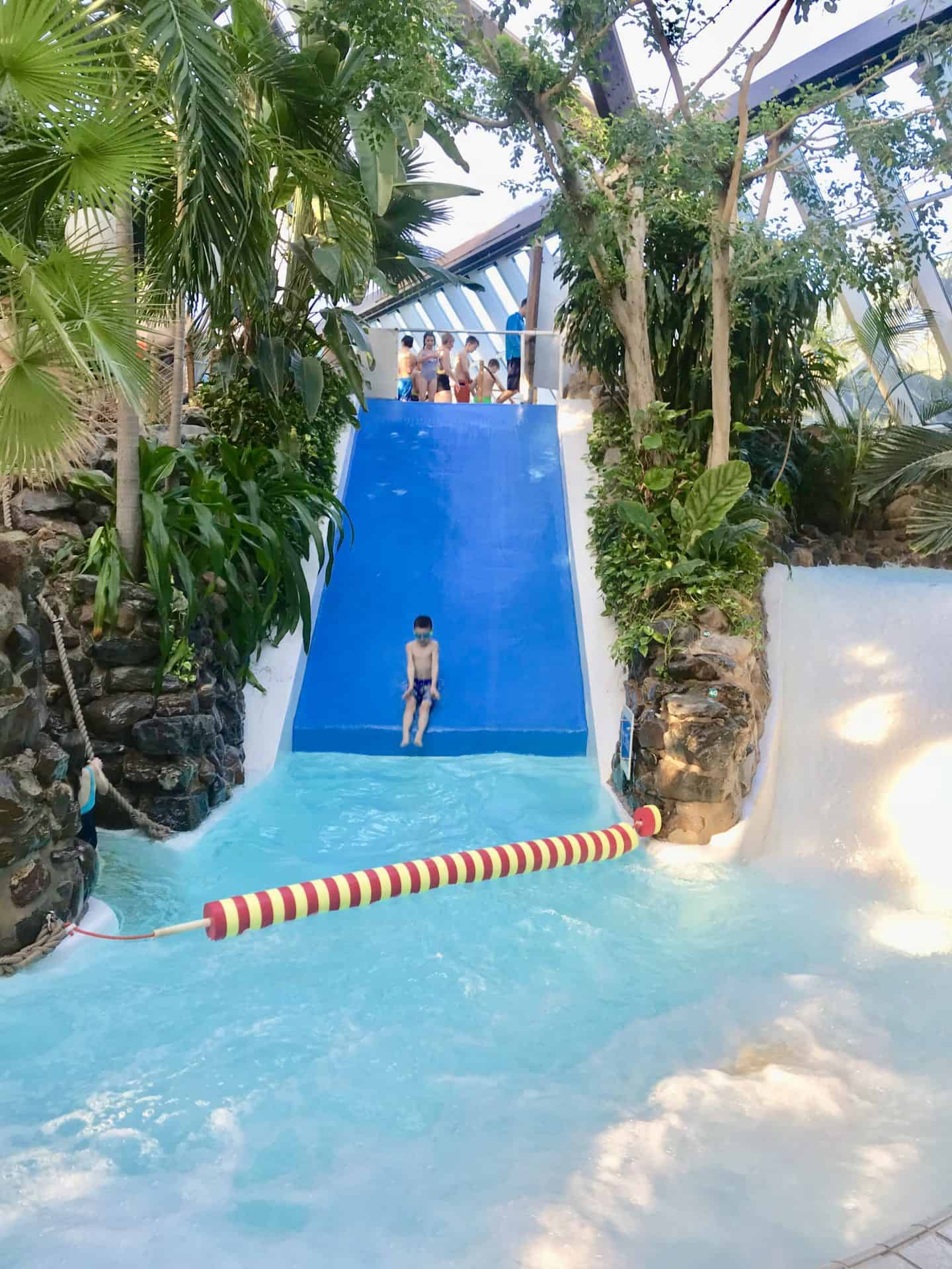B coming down the steep slide at Subtropical Paradise