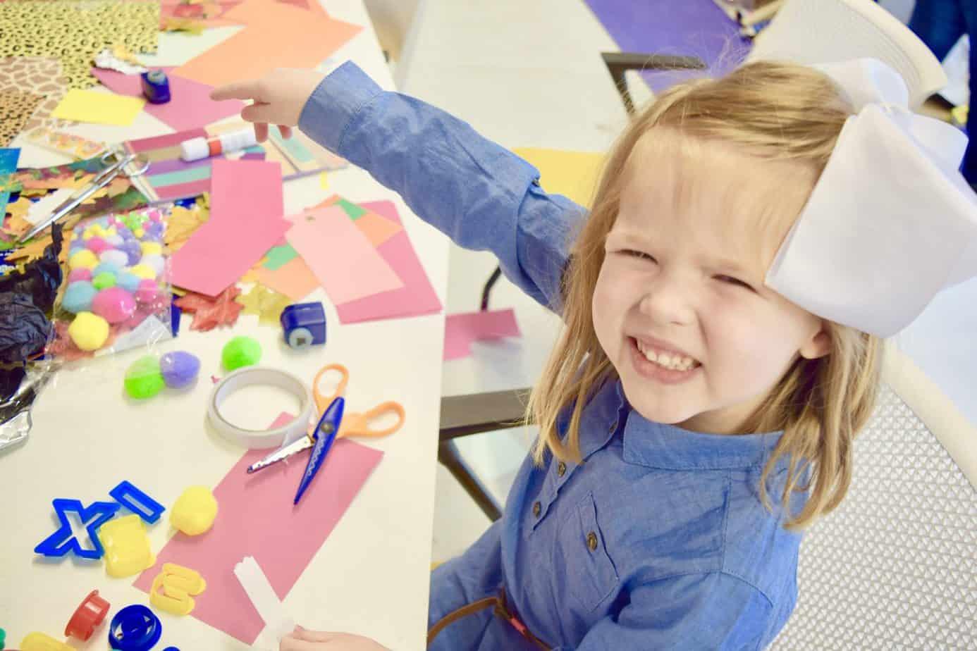W enjoying some crafts at Playfest, playtopia