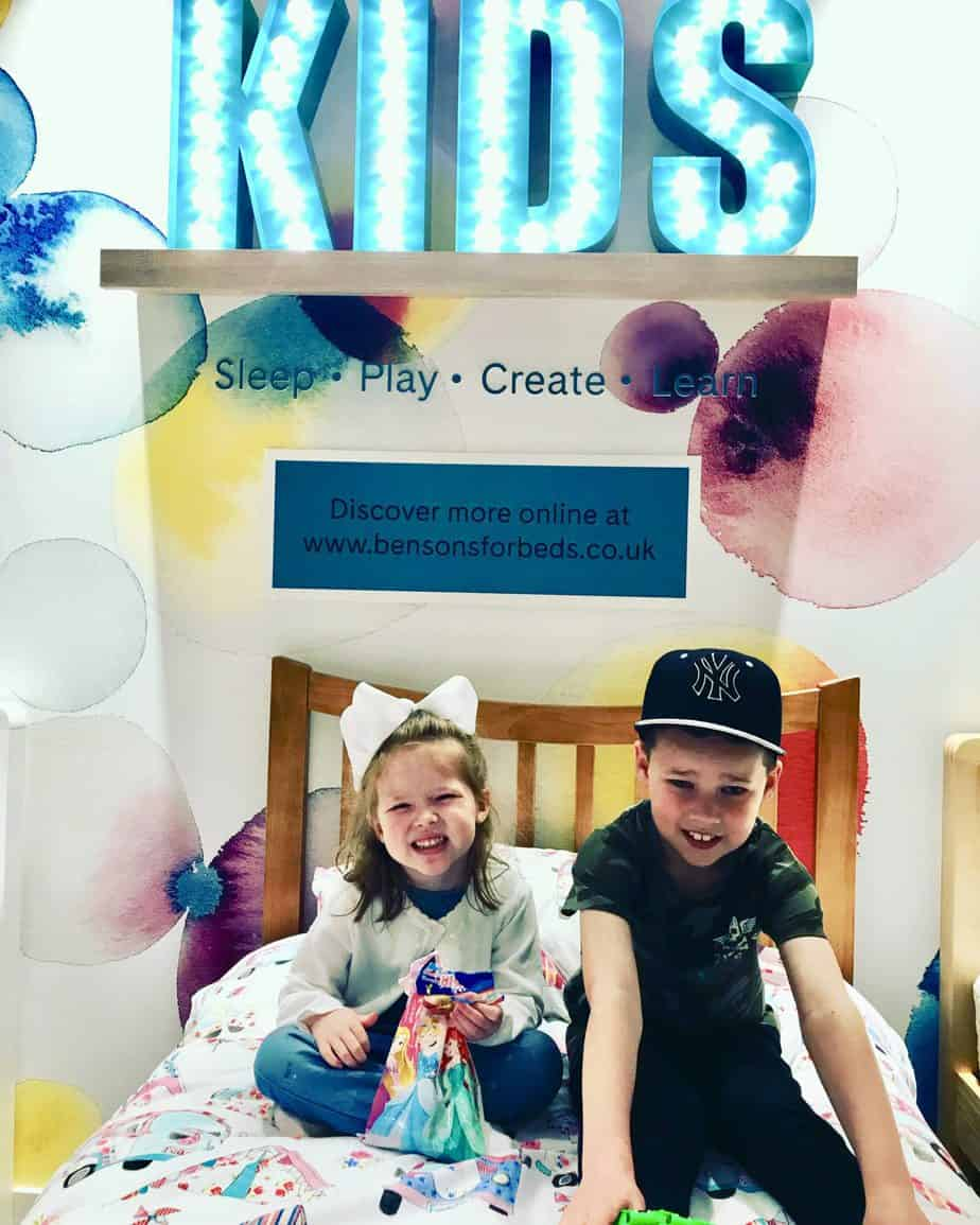 B and W testing out the chidlren's beds in Benson for beds during the bedtime stories event at wenesbury store