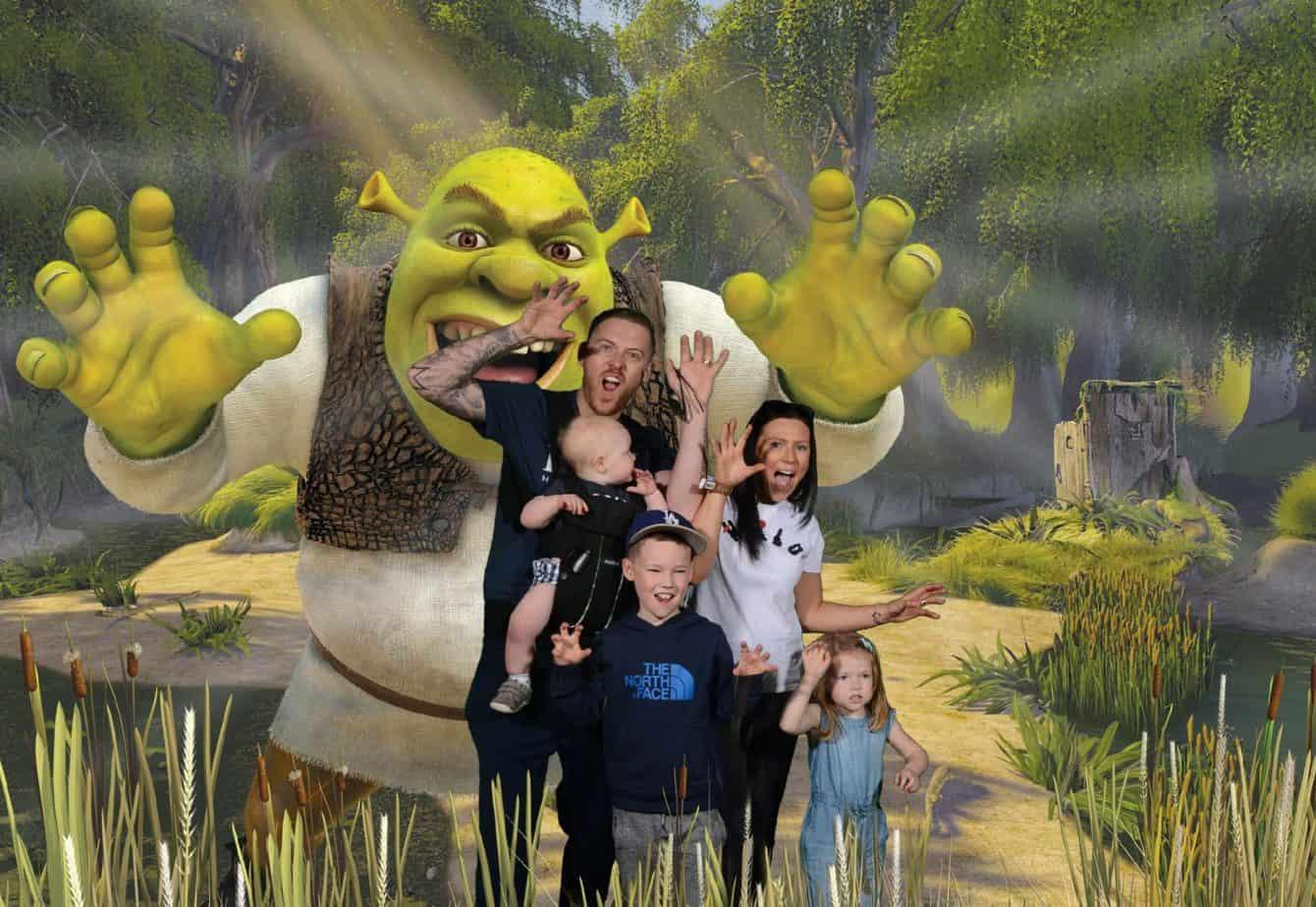Us 5 in front of shrek at Shrek's Adventure