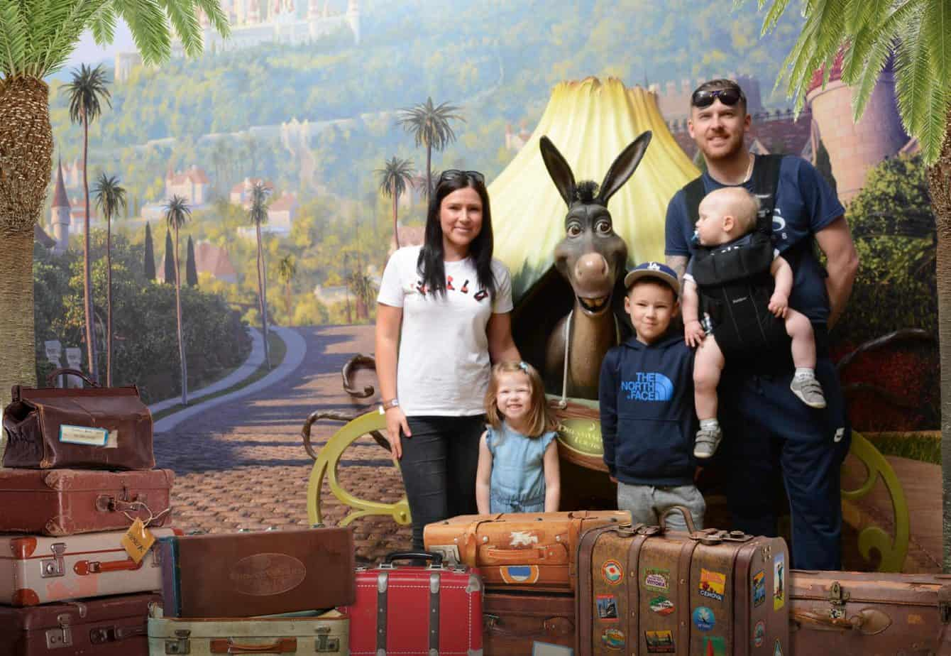 A photo of us 5 with Donkey a Shrek's Adventure