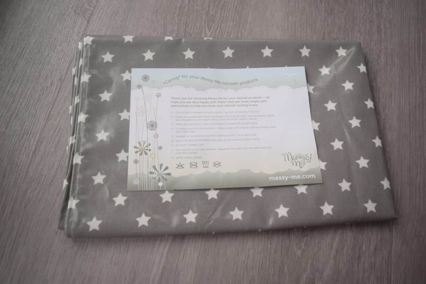 messy me splash mat in grey with starts folded up ready to use