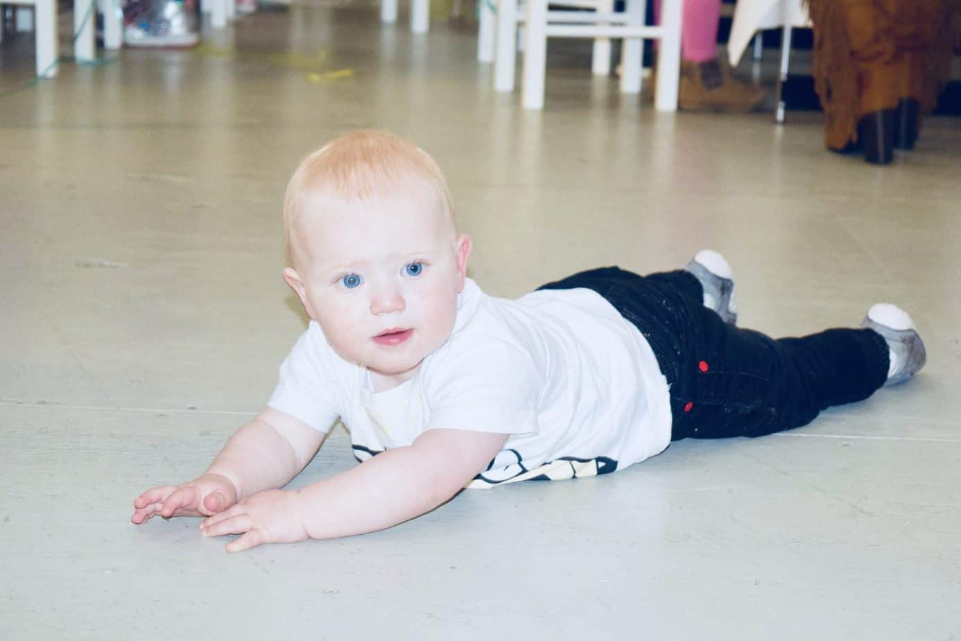 Baby K on the floor at Yellow Zebra Safaris event
