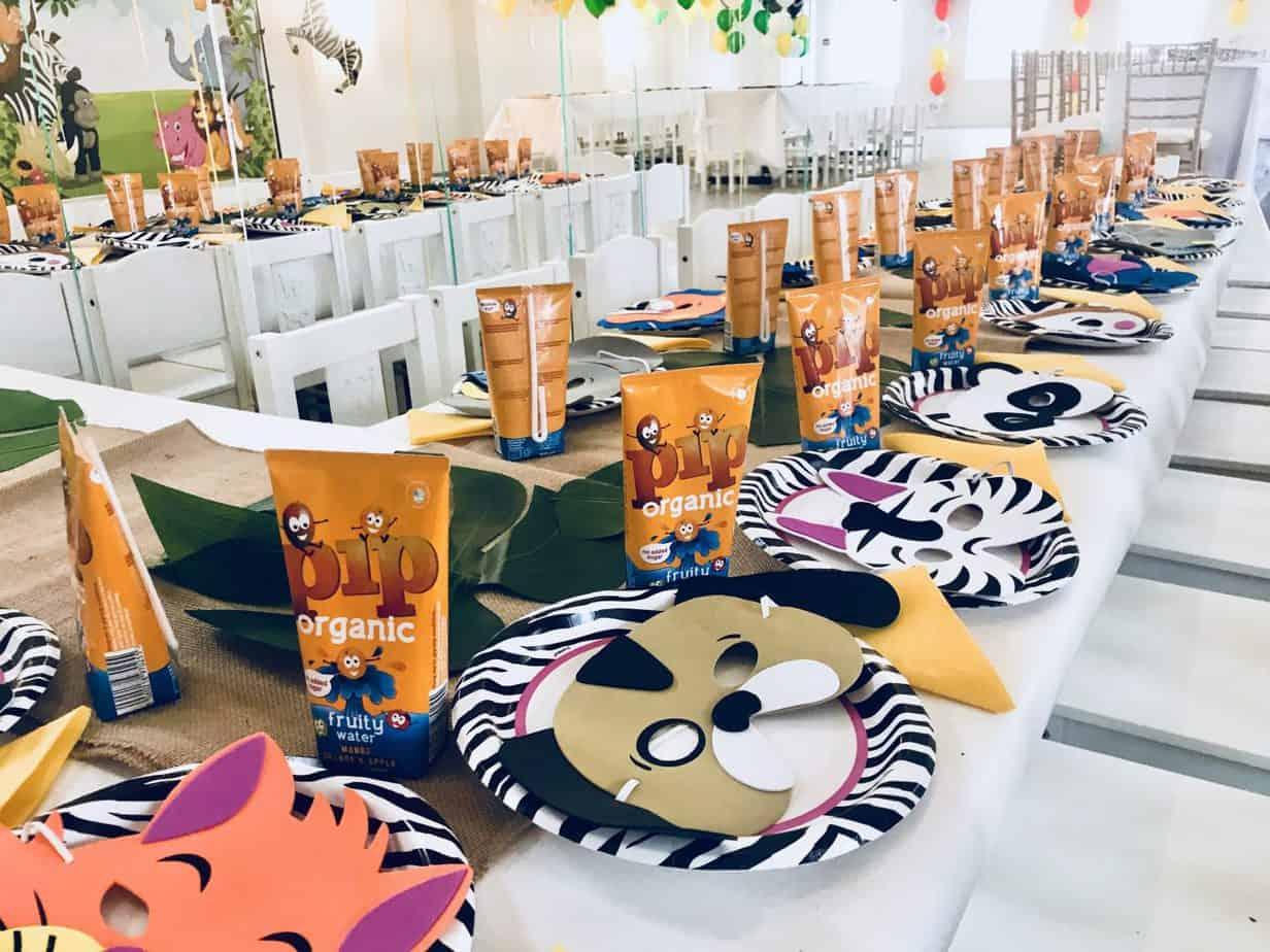 A close up of the children's table decorated safari theme at Yellow Zebra Safari's blogger event