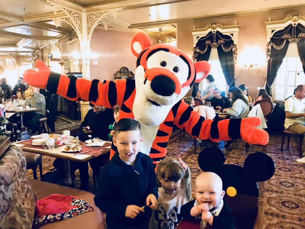 The three kids meeting Tigger at Character breakfast at Disneyland Paris
