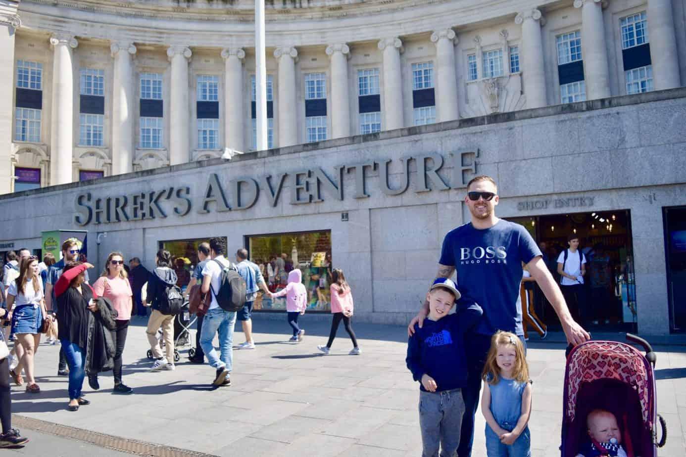 Matt and the children outside shrek's adventure in London