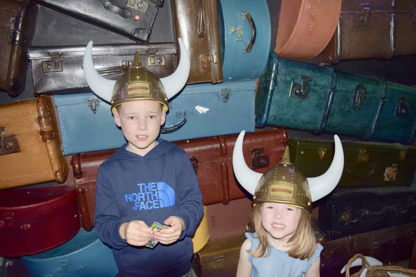 B and W wearing viking hats whilst waiting in the queue at Shrek's Adventure