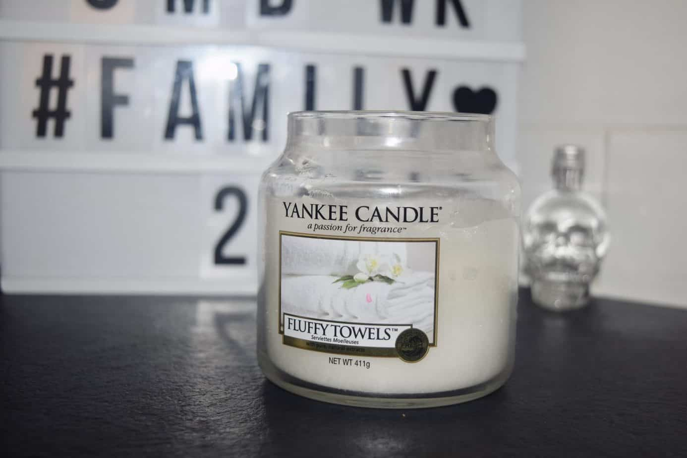 A close up a yankee candle in my kitchen