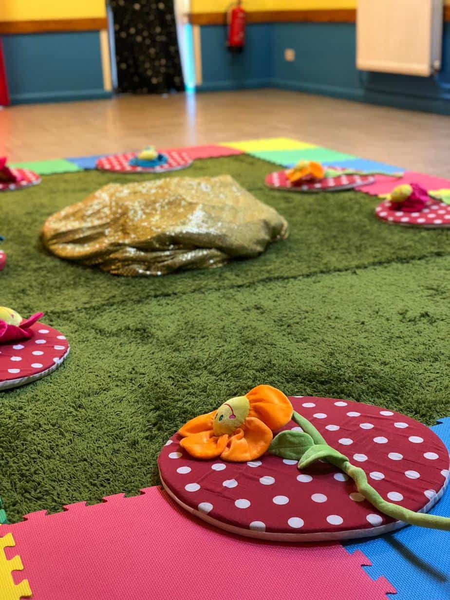 Baby class Hartbeeps all set up with mats in a circle and a flower rprop on each mat