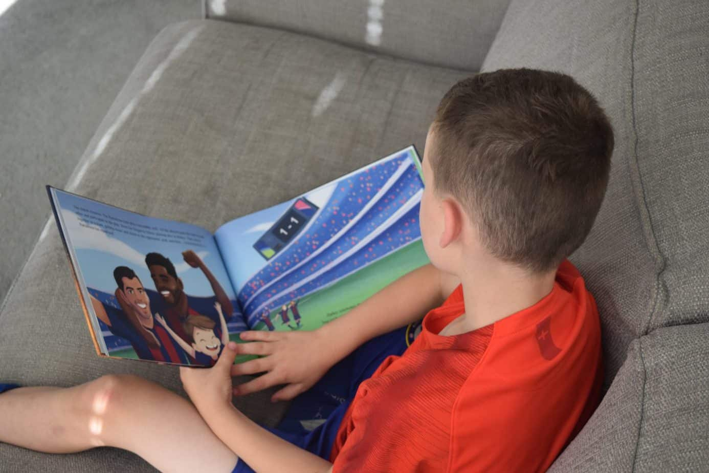 B reading the Barcelona FC personalised football book