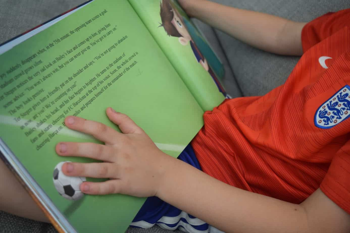 B holding his Barcelona FC book from The Magic Story