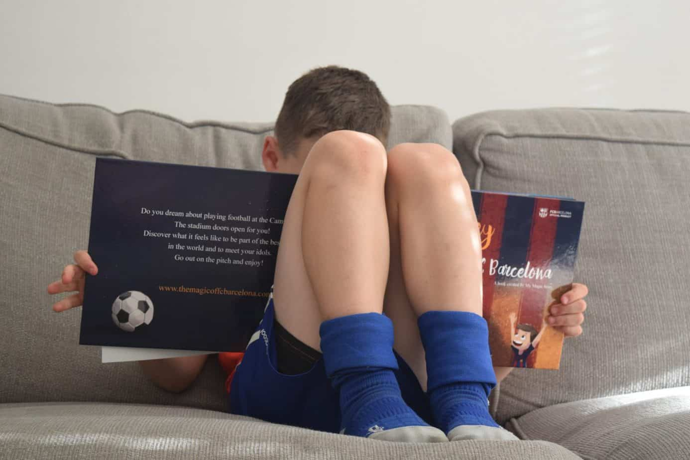 B reading his Barcelona personalised football book