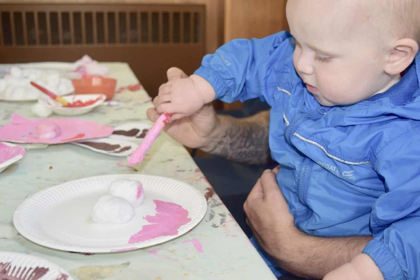 Baby K painting peppa pig at Arty Splats