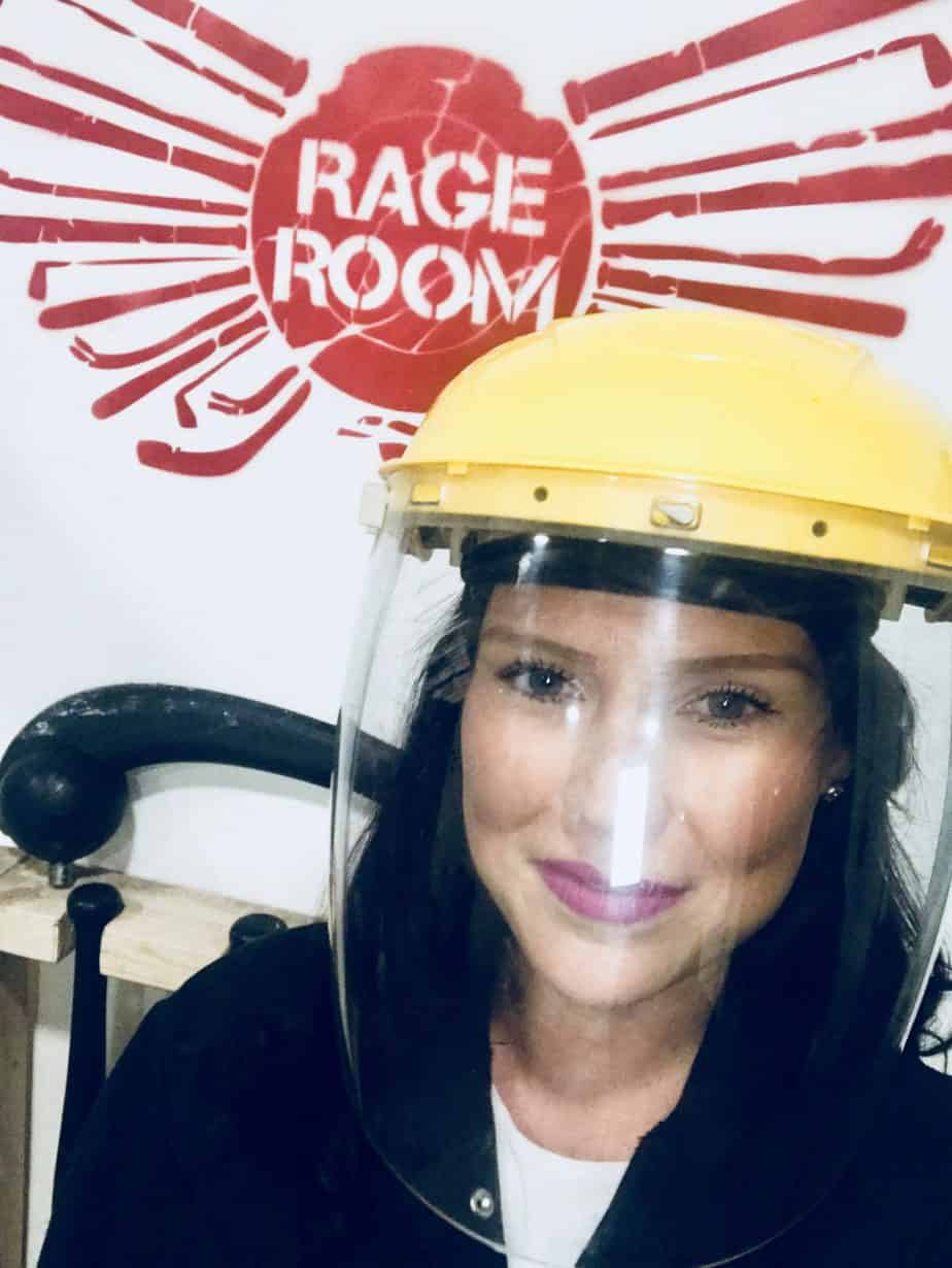 Me, wearing my face protector at Rage Room, an activity with Buckt