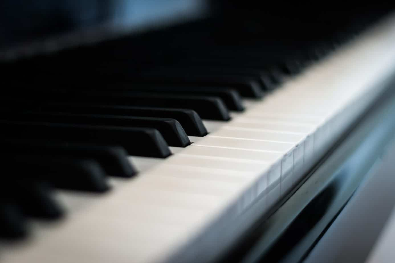 a close up of the keys on a piano