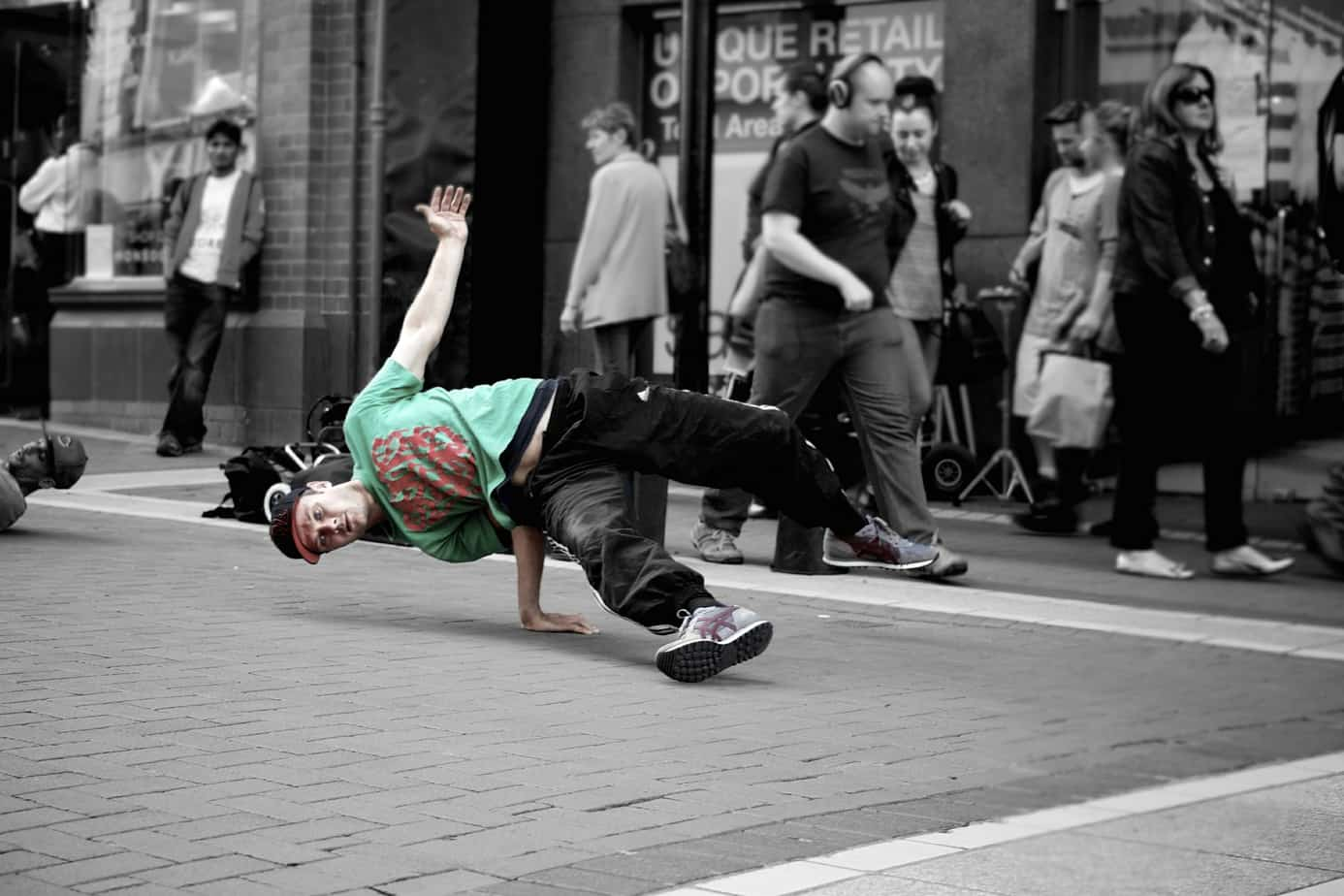 A boy breakdancing at the Birmingham Dance festival