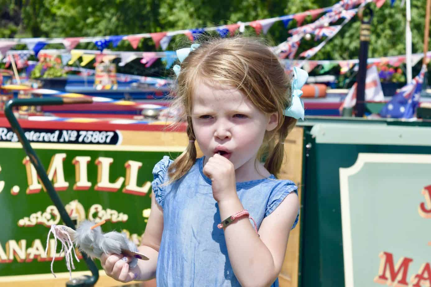 W having a lolly with her ID bracelet on her wrist whilst at a festival