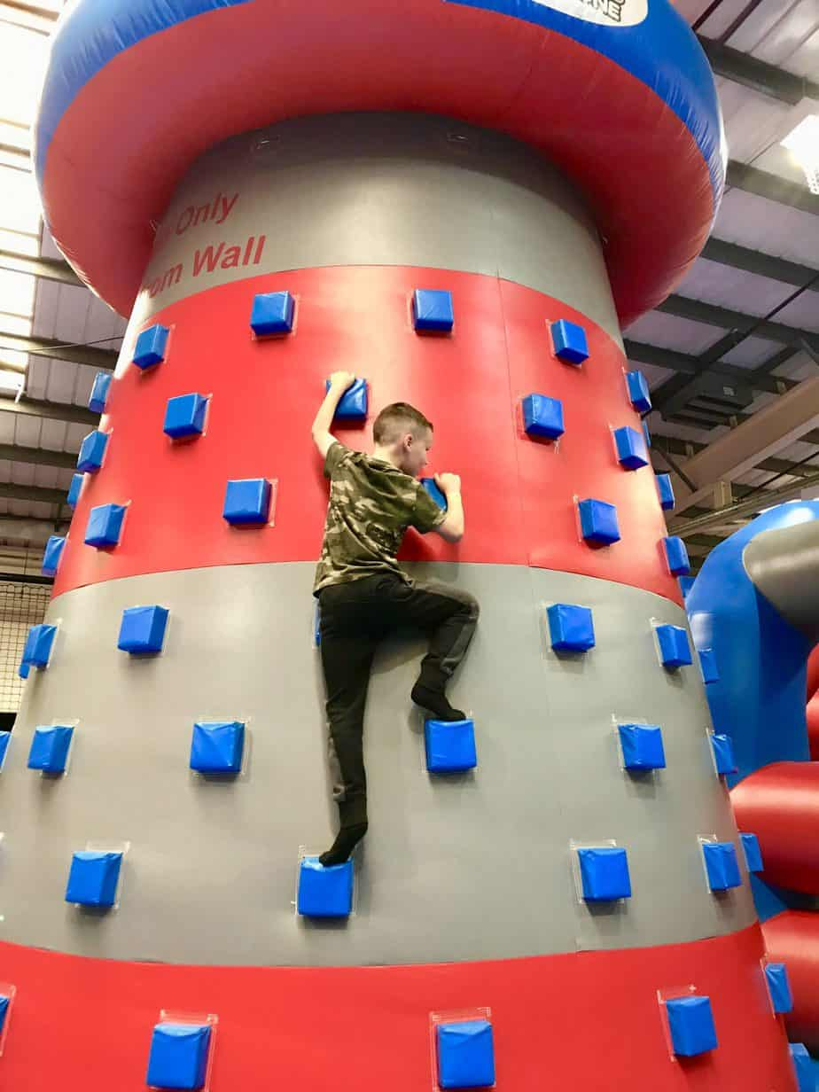 B being brave on the climbing wall at Inflatable zone