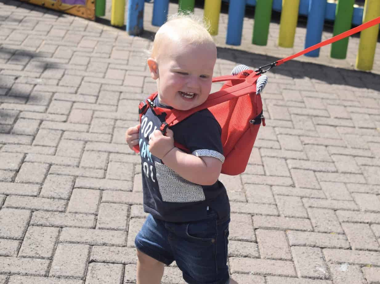 Baby K wearing reins