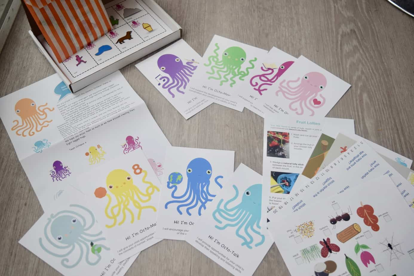 The contents of our octopus learning subscription box including octopus cards, creative items and work sheets