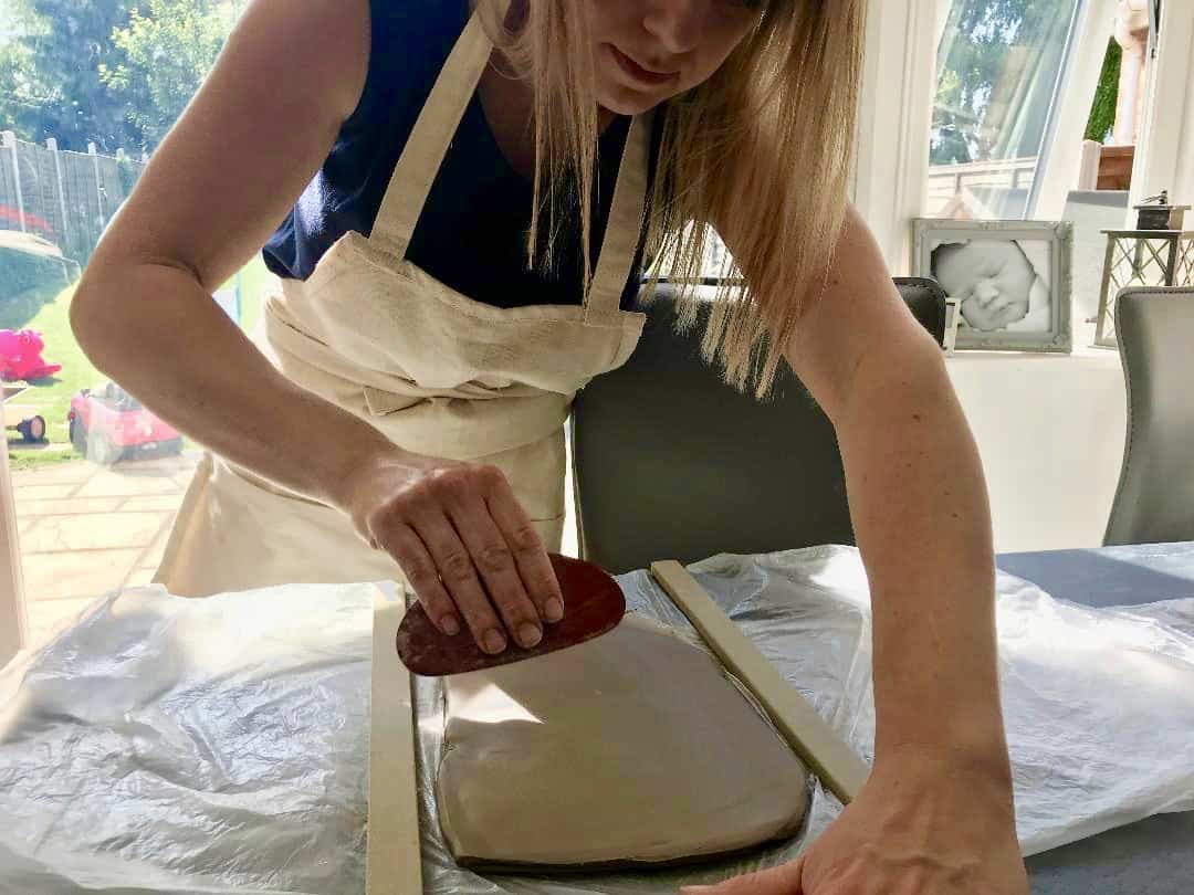Sarah from Blossom Keepsakes prepping the clay at our home