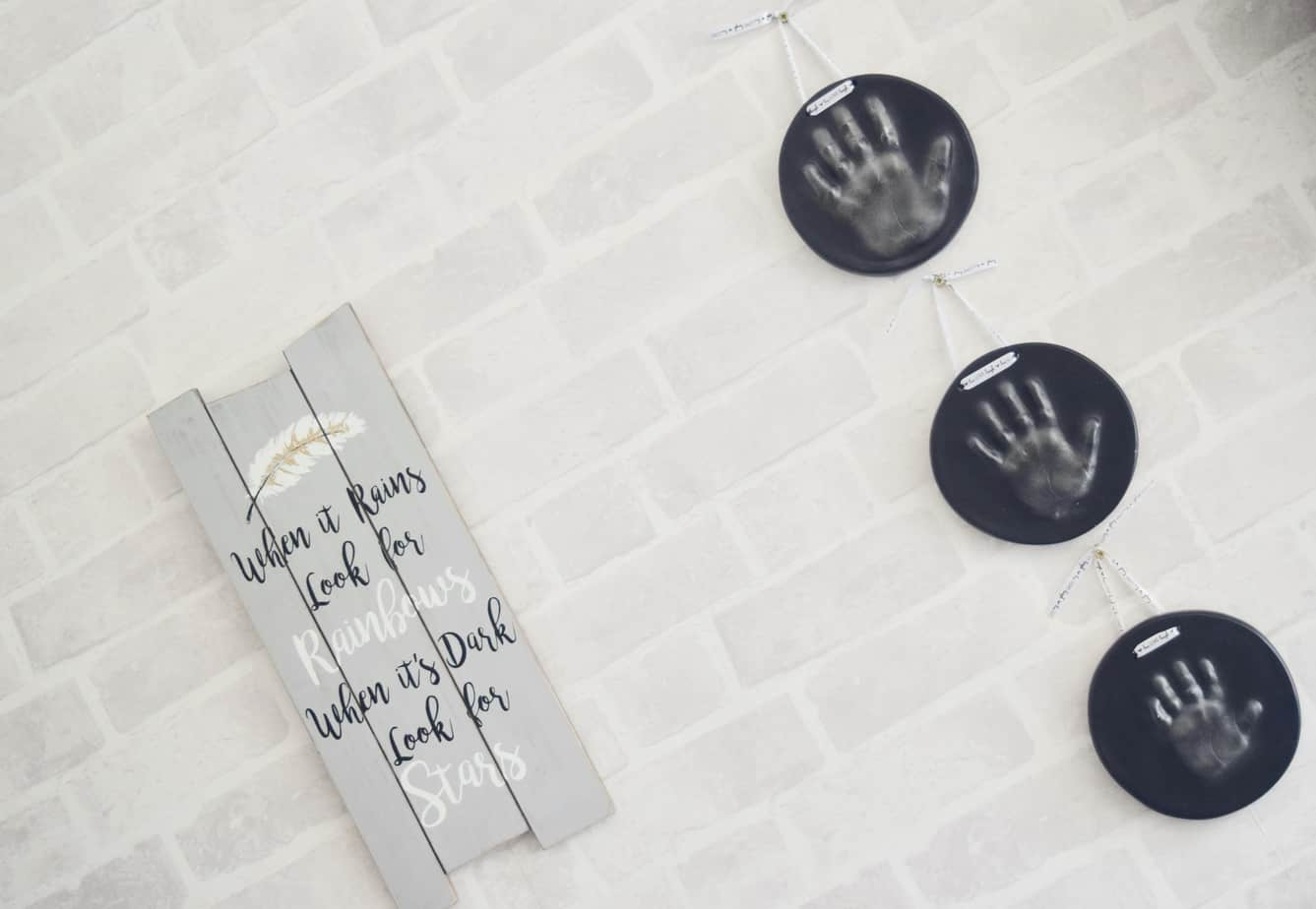 Three imprints in black on the wall