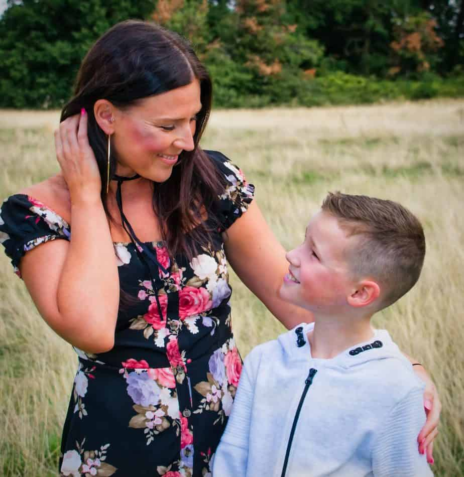 Me and B looking at each other in front of a field at the park smiling taken by Everlasting memories photography UK
