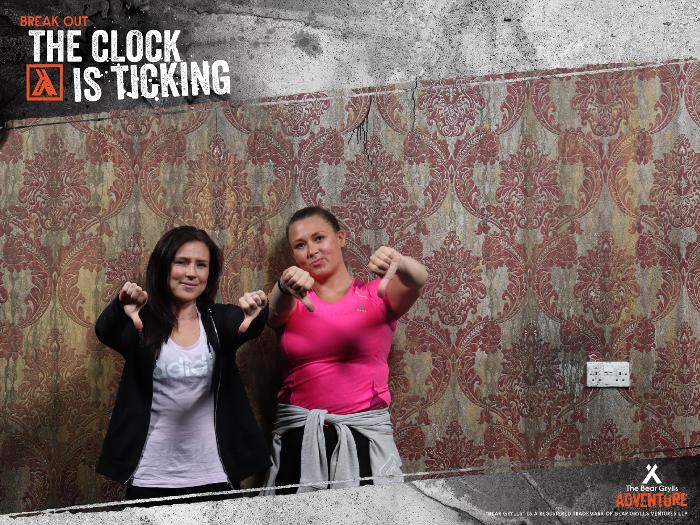 my sister and I with our thumbs down after not escaping the escape rooms at Bear grylls adventure