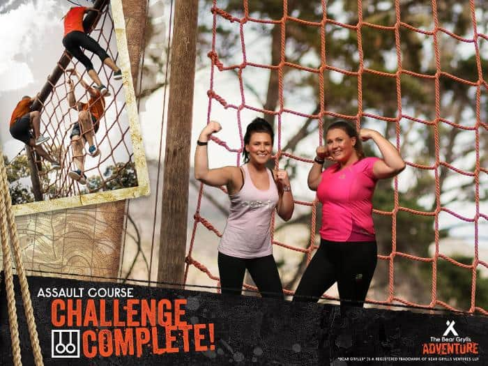 My sister and I flexing our muscles after the assault course at bear grylls adventure