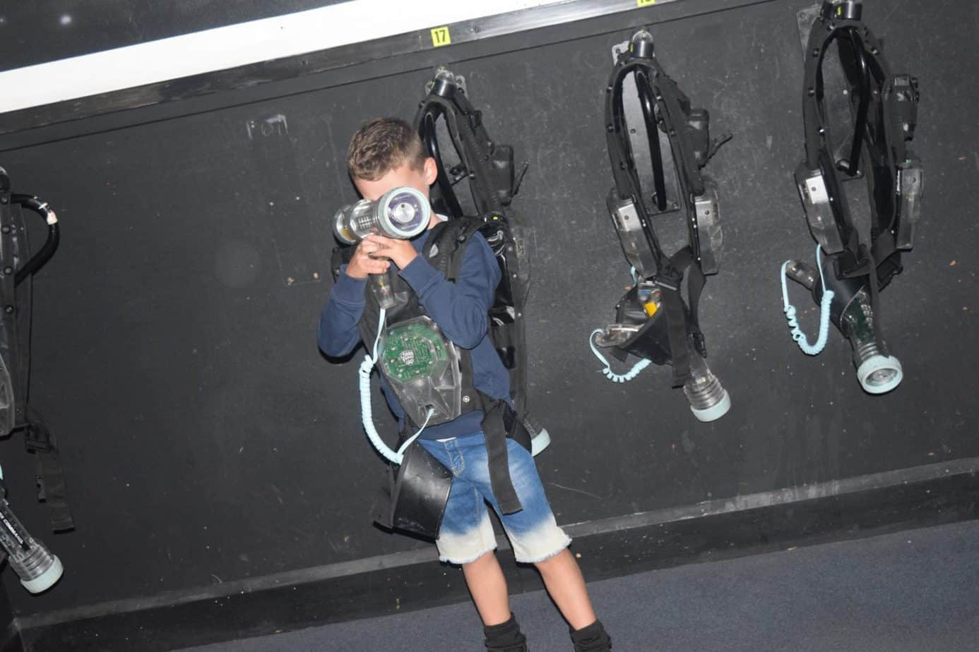 B at Laser Tag, an activity provided by Buckt subscription box. He is holding his infrared blaster