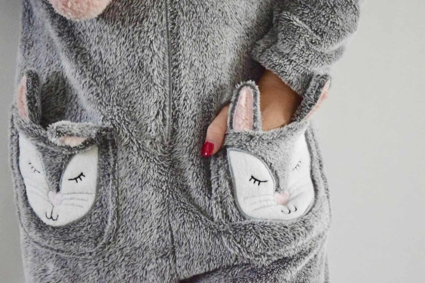 a close up of my hand in the rabbit pocket - onesie by Hunkemoller