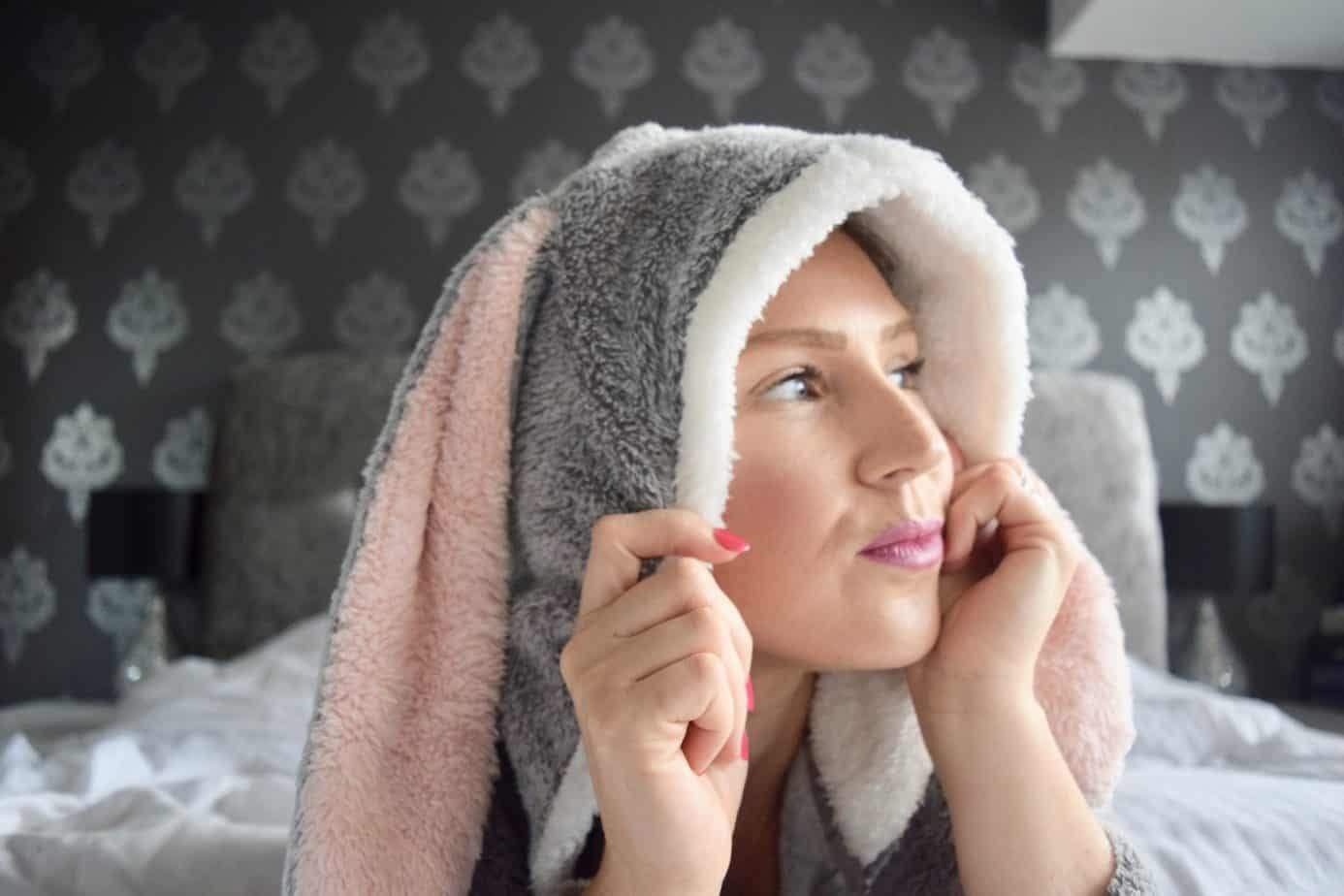 A close up of me with the hood up of the onesie made by Hunkemoller