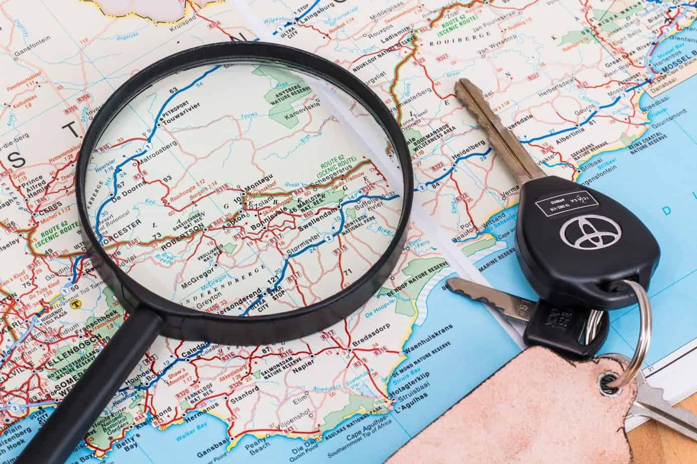 A map, magnifying glass and car keys are all ready for our next road trip with kids
