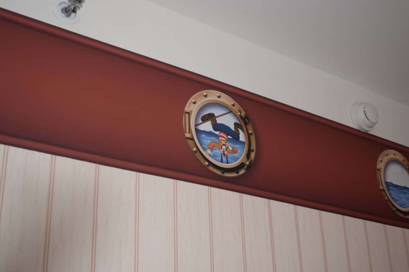 The wallpaper in a standard room at Newport Bay hotel is nautical themed featuring some of the disney characters