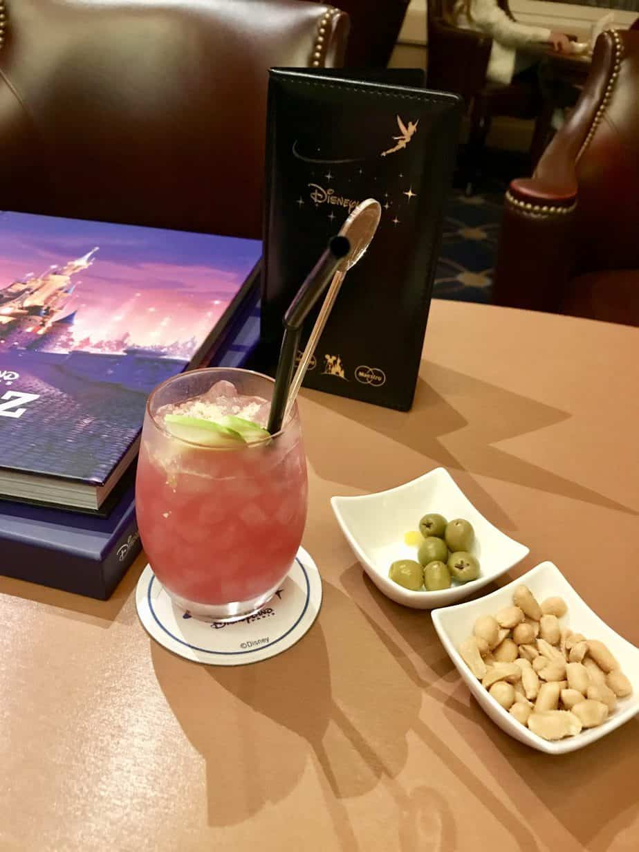 Cocktail and complimentary nuts and olives at the bar at Newport Bay hotel in Disneyland paris