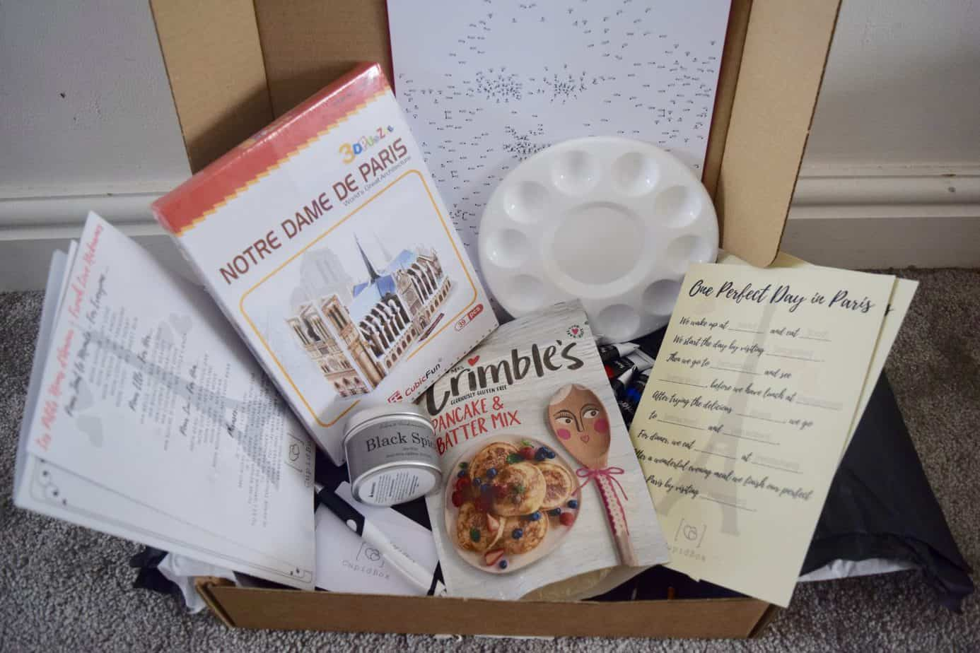 All of our goodies inside our cupid box, including pancake mix, painting items, and a 3D puzzle
