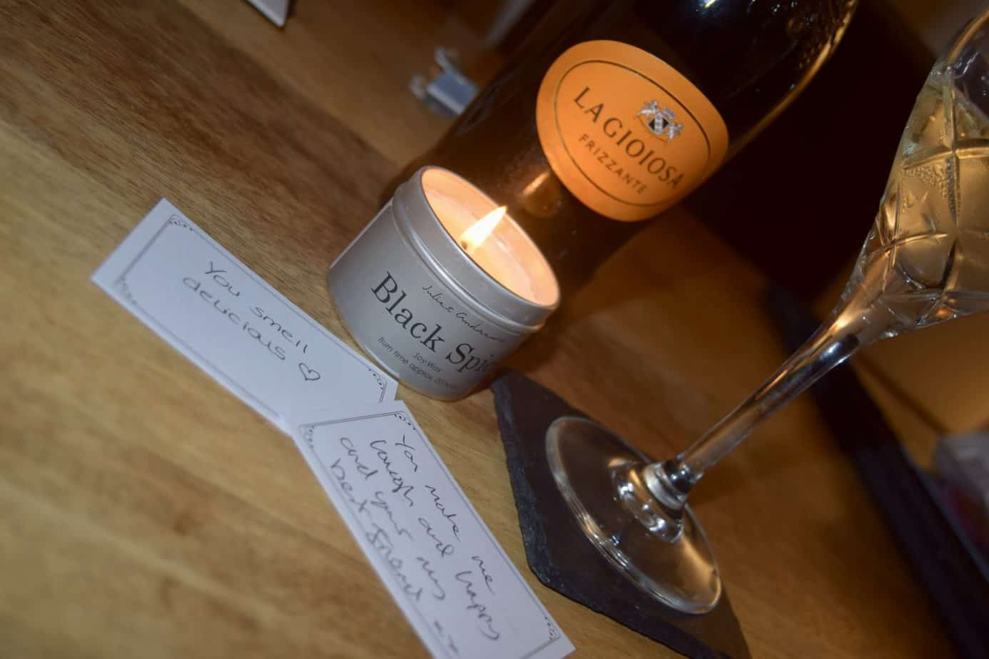 2 of our compliment cards with the candle, bottle of fizz and a wine glass