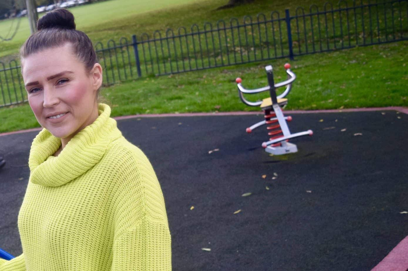 At the playground with me smiling at the camera showcasing Femme Luxe autumn wear jumper