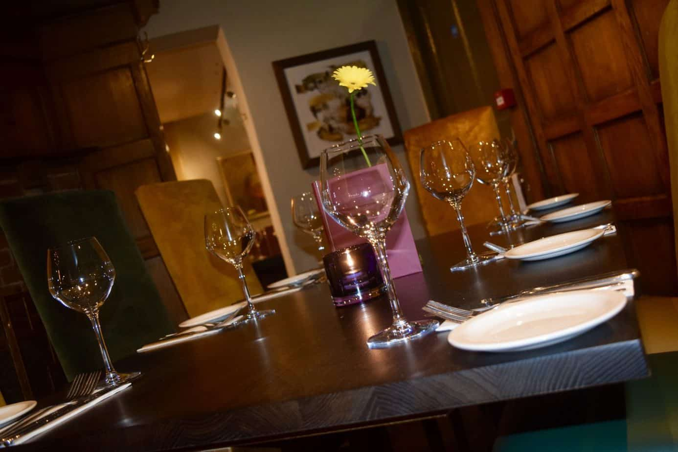 A close up of a table with wine glasses at The Bulls Head in Meriden