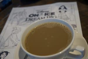 A close up of my coffee with Disney on ice colouring
