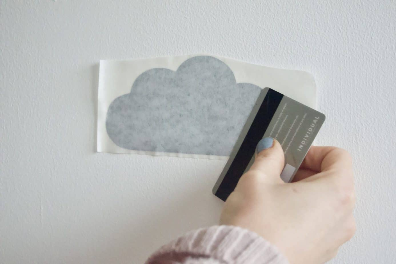Me running a card over the cloud wall sticker