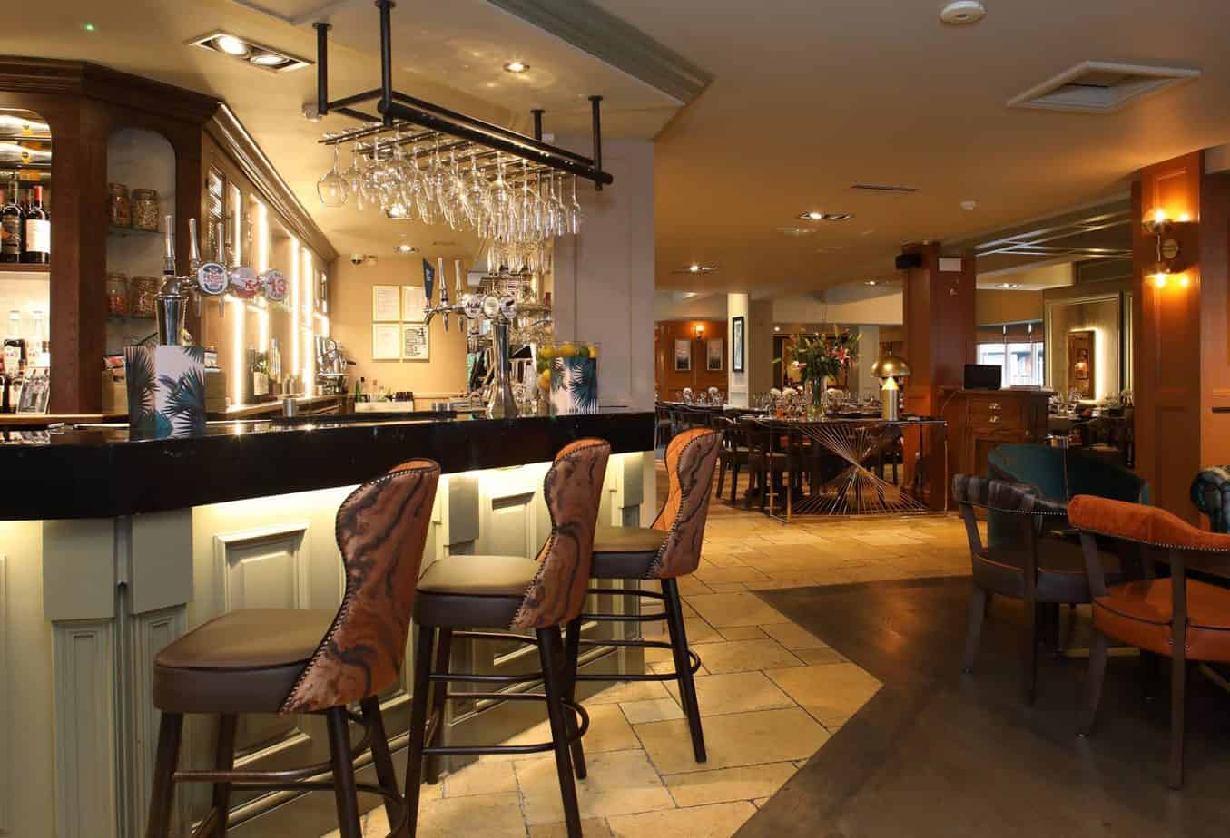 The bar area leading to the restaurant at The Green House Pub in Sutton Coldfield
