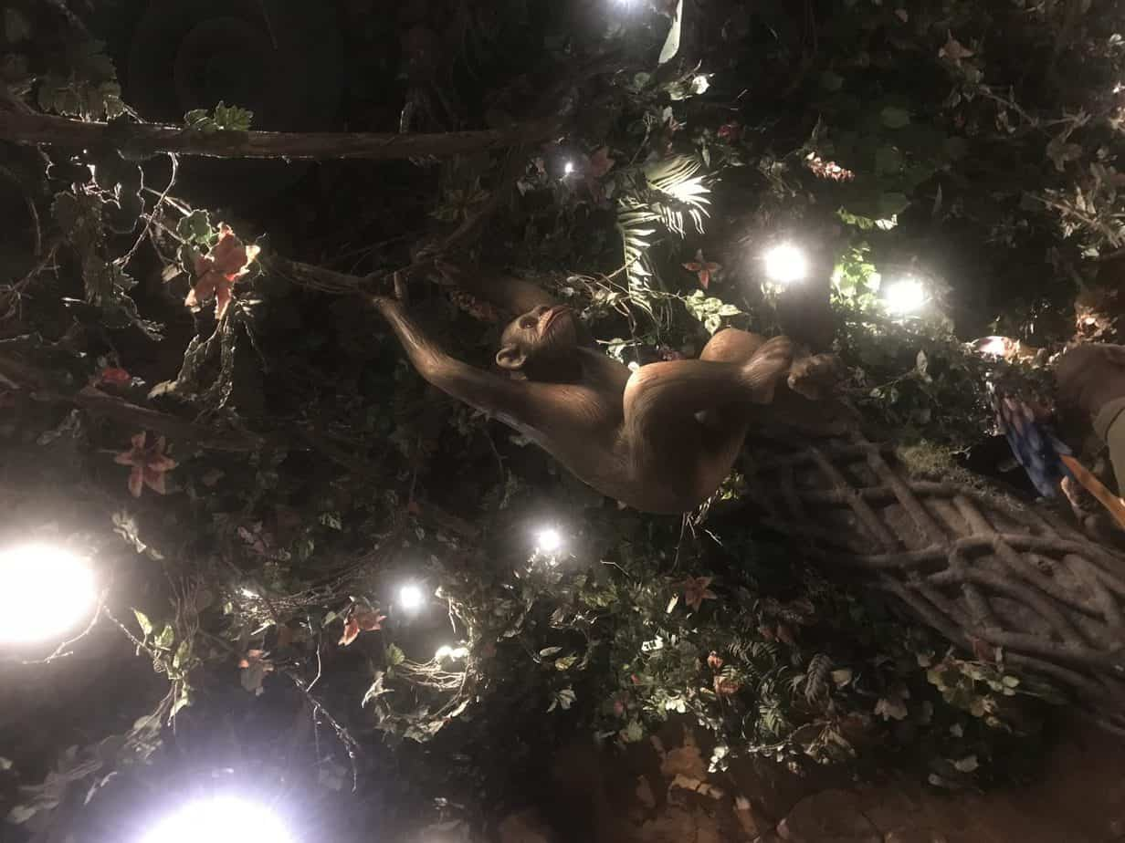 A monkey on the ceiling hanging off rainforest vines at Rainforest cafe at disneyland paris as part of our disneyland paris trip report 2018